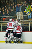 Baldwinsville Bees players celebrate Charlie Bertrand's (15) goal against the West Genesee Wildcats at the Greater Baldwinsville Ice Arena in a Section III Division I Boys Hockey Playoff game at Baldwinsville, New York on Tuesday February 24, 2015.  Baldwinsville won 5-0.