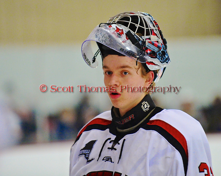 Baldwinsville Bees goalie Matt Sabourin (31) during a time out at the Greater Baldwinsville Ice Arena in a Section III Division I Boys Hockey Playoff game at Baldwinsville, New York on Tuesday February 24, 2015.  Baldwinsville won 5-0.