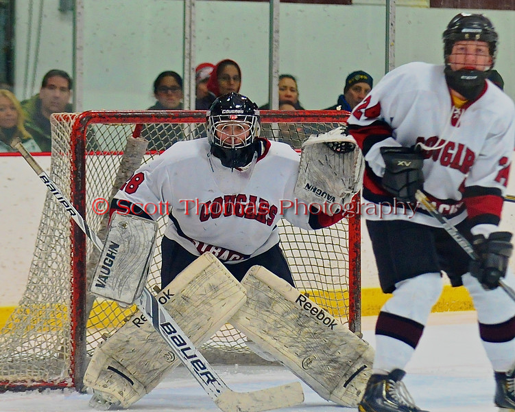 Syracuse Cougars Same Walsh (28) in net against the West Genesee Wildcats at Meachem Ice Rink in Syracuse, New York on Wednesday, January 28, 2015. Syracuse won 5-4.