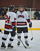 Syracuse Cougars Matt Eccles (24) congratulates Sean Eccles (3) on this goal against the West Genesee Wildcats at Meachem Ice Rink in Syracuse, New York on Wednesday, January 28, 2015. Syracuse won 5-4.
