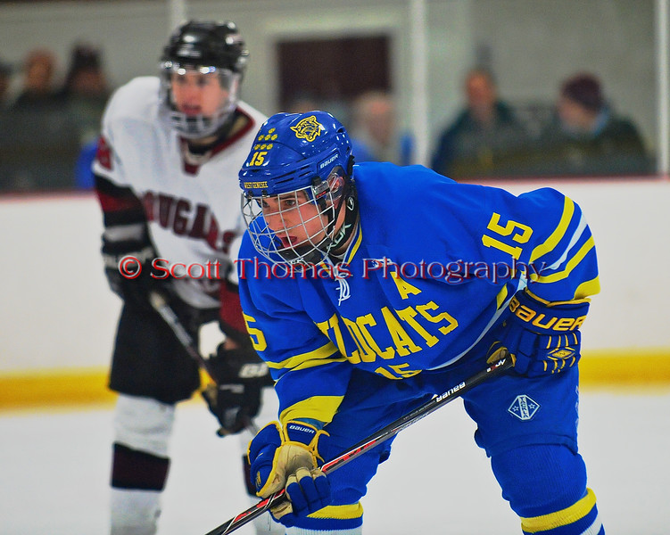 West Genesee Wildcats Derek Farrell (15) awaiting a face-off against the Syracuse Cougars at Meachem Ice Rink in Syracuse, New York on Wednesday, January 28, 2015. Syracuse won 5-4.