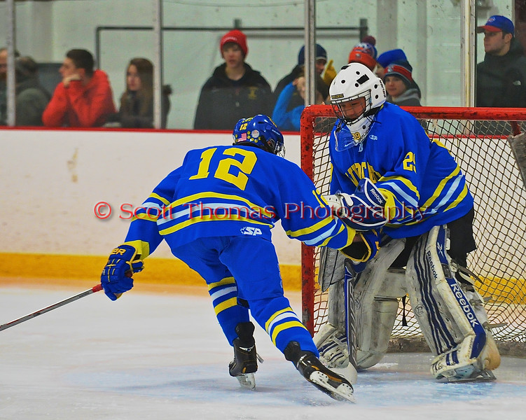 West Genesee Wildcats Matthew McDonald (12) and goalie Sammy Calabufo (29) touch gloves before playing the Syracuse Cougars at Meachem Ice Rink in Syracuse, New York on Wednesday, January 28, 2015. Syracuse won 5-4.