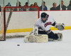 Syracuse Cougars goalie Sam Walsh (28) makes a save against the West Genesee Wildcats at Meachem Ice Rink in Syracuse, New York on Wednesday, January 28, 2015. Syracuse won 5-4.