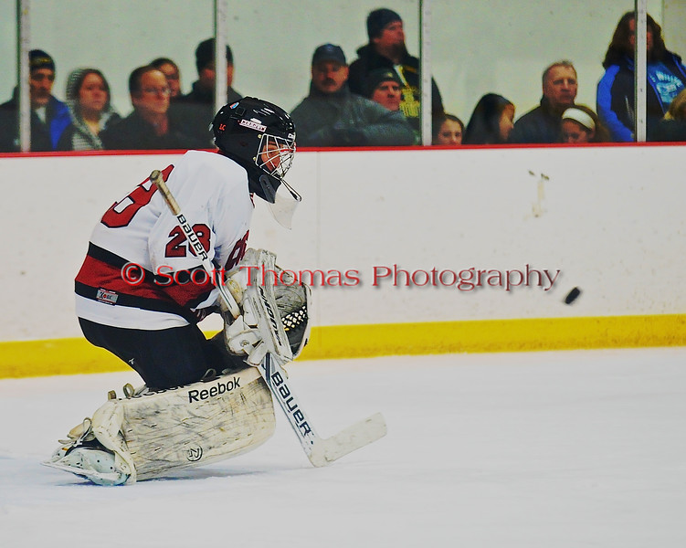 Syracuse Cougars goalie Sam Walsh (28) about to make a save against the West Genesee Wildcats at Meachem Ice Rink in Syracuse, New York on Wednesday, January 28, 2015. Syracuse won 5-4.