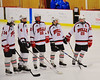 Baldwinsville Bees Charlie McAllister (14), Ben Dwyer (4), Matt Monaco (22), Kyle Lindsay (26)  and Matt Abbott (29) being introduced before playing the Watertown IHC Cavaliers at the Greater Baldwinsville Ice Arena in Baldwinsville, New York on Tuesday January 20, 2015.  Baldwinsville won 10-0.