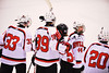 Baldwinsville Bees teammates, Jimmy Dugan (33), Shane Sweeney (44), Anthony Pompo (55) and Ryan Gebhardt (20) congratulate Brett Sabourin (39) for his goal against the Watertown IHC Cavaliers at the Greater Baldwinsville Ice Arena in Baldwinsville, New York on Tuesday January 20, 2015.  Baldwinsville won 10-0.