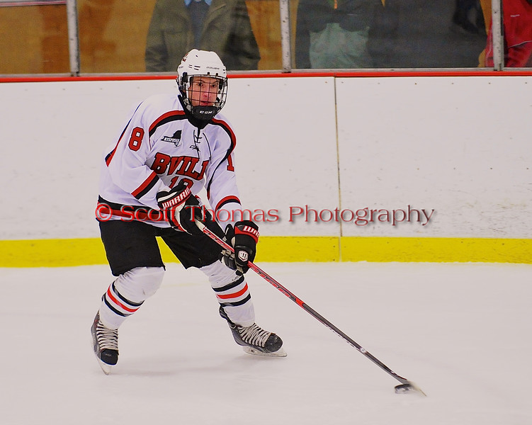 Baldwinsville Bees Riley Smith (8) with the puck against the Watertown IHC Cavaliers at the Greater Baldwinsville Ice Arena in Baldwinsville, New York on Tuesday January 20, 2015.  Baldwinsville won 10-0.