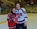 Baldwinsville Bees Brett Sabourin (39) with his teacher, Mrs. Gates, on Teacher Appreciation Night at the Lysander Ice Arena in Baldwinsville, New York on Monday February 8, 2016.