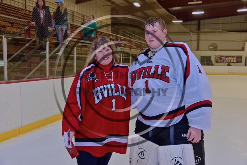 Baldwinsville Bees goalie Josh Smith (1) with his teacher, Mrs. Sholette, on Teacher Appreciation Night at the Lysander Ice Arena in Baldwinsville, New York on Monday February 8, 2016.