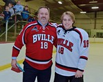 Baldwinsville Bees Garrett Gray (18) with his teacher, Mr. Young, on Teacher Appreciation Night at the Lysander Ice Arena in Baldwinsville, New York on Monday February 8, 2016.