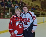 Baldwinsville Bees Anthony Pompo (55) with his teacher, Mrs. Southard, on Teacher Appreciation Night at the Lysander Ice Arena in Baldwinsville, New York on Monday February 8, 2016.