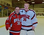 Baldwinsville Bees goalie Alex Rose (35) with his teacher, Mr. Fortais, on Teacher Appreciation Night at the Lysander Ice Arena in Baldwinsville, New York on Monday February 8, 2016.