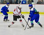 Baldwinsville Bees Connor Carhart (12) has his shot blocked by Cicero/North Syracuse Northstars Parker Lane (25) at the Lysander Ice Arena in Baldwinsville, New York on Monday February 8, 20 ...