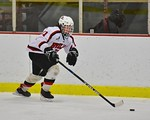 Baldwinsville Bees Noah Lindsay (21) carrying the puck against the Cicero/North Syracuse Northstars at the Lysander Ice Arena in Baldwinsville, New York on Monday February 8, 2016. Cicero/No ...