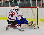 Baldwinsville Bees Garrett Gray (18) has his shot turned aside by Cicero/North Syracuse Northstars goalie Jack Doren (30) at the Lysander Ice Arena in Baldwinsville, New York on Monday Febru ...