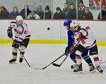 Baldwinsville Bees Andrew Starrantino (25) deflects the puck away from a Cicero/North Syracuse Northstars player at the Lysander Ice Arena in Baldwinsville, New York on Monday February 8, 20 ...