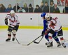 Baldwinsville Bees Andrew Starrantino (25) deflects the puck away from a Cicero/North Syracuse Northstars player at the Lysander Ice Arena in Baldwinsville, New York on Monday February 8, 2016. Cicero/North Syracuse won 2-1.