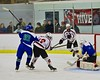 Cicero/North Syracuse Northstars goalie Jack Doren (30) makes a save as Baldwinsville Bees Connor Carhart (12) looks for a rebound at the Lysander Ice Arena in Baldwinsville, New York on Monday February 8, 2016. Cicero/North Syracuse won 2-1.