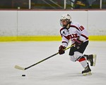 Baldwinsville Bees Garrett Gray (18) with the puck against the Cicero/North Syracuse Northstars at the Lysander Ice Arena in Baldwinsville, New York on Monday February 8, 2016. Cicero/North  ...
