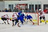 Baldwinsville Bees and Cicero/North Syracuse Northstars players battle for the puck at the Lysander Ice Arena in Baldwinsville, New York on Monday February 8, 2016. Cicero/North Syracuse won 2-1.