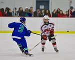 Baldwinsville Bees Matt Metcalf (27) defending against Cicero/North Syracuse Northstars Robert Mitchell (3) at the Lysander Ice Arena in Baldwinsville, New York on Monday February 8, 2016. C ...