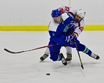 Baldwinsville Bees Chris Speelman (23) checks Cicero/North Syracuse Northstars Logan Field (18) at the Lysander Ice Arena in Baldwinsville, New York on Monday February 8, 2016. Cicero/North  ...