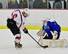Baldwinsville Bees Josh Racha (6) is stopped by Cicero/North Syracuse Northstars goalie Jack Doren (30) at the Lysander Ice Arena in Baldwinsville, New York on Monday February 8, 2016. Cicero/North Syracuse won 2-1.