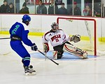 Baldwinsville Bees goalie Matt Sabourin (31) makes a pad save on Cicero/North Syracuse Northstars Dante Ianotti (2) at the Lysander Ice Arena in Baldwinsville, New York on Monday February 8, ...