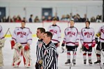 Referees during the National Anthem before the Baldwinsville Bees and Cicero/North Syracuse Northstars hockey game at the Lysander Ice Arena in Baldwinsville, New York on Monday February 8,  ...