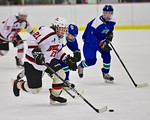 Baldwinsville Bees Noah Lindsay (21) with the puck against the Cicero/North Syracuse Northstars at the Lysander Ice Arena in Baldwinsville, New York on Monday February 8, 2016. Cicero/North  ...