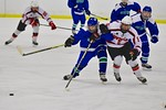 Baldwinsville Bees Isaiah Pompo (5) and a Cicero/North Syracuse Northstars player go after the puck at the Lysander Ice Arena in Baldwinsville, New York on Monday February 8, 2016. Cicero/No ...