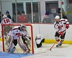 Baldwinsville Bees Matt Metcalf (27) brings the puck out from behind his net against the Fayetteville-Manlius Hornets at the Lysander Ice Arena in a Section III Division I Boys Hockey Playof ...