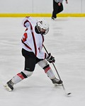 Baldwinsville Bees Connor Carhart (12) fires the puck at the Fayetteville-Manlius Hornets net at the Lysander Ice Arena in a Section III Division I Boys Hockey Playoff game at Baldwinsville, ...