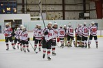 Baldwinsville Bees Josh Racha (6) and his teammates celebrate a win over the Fayetteville-Manlius Hornets at the Lysander Ice Arena in a Section III Division I Boys Hockey Playoff game at Ba ...