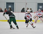 Baldwinsville Bees Brett Sabourin (39) defending against a Fayetteville-Manlius Hornets player at the Lysander Ice Arena in a Section III Division I Boys Hockey Playoff game at Baldwinsville ...