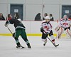 Baldwinsville Bees Brett Sabourin (39) defending against a Fayetteville-Manlius Hornets player at the Lysander Ice Arena in a Section III Division I Boys Hockey Playoff game at Baldwinsville, New York on Thursday February 18, 2016.  Baldwinsville won 5-0.