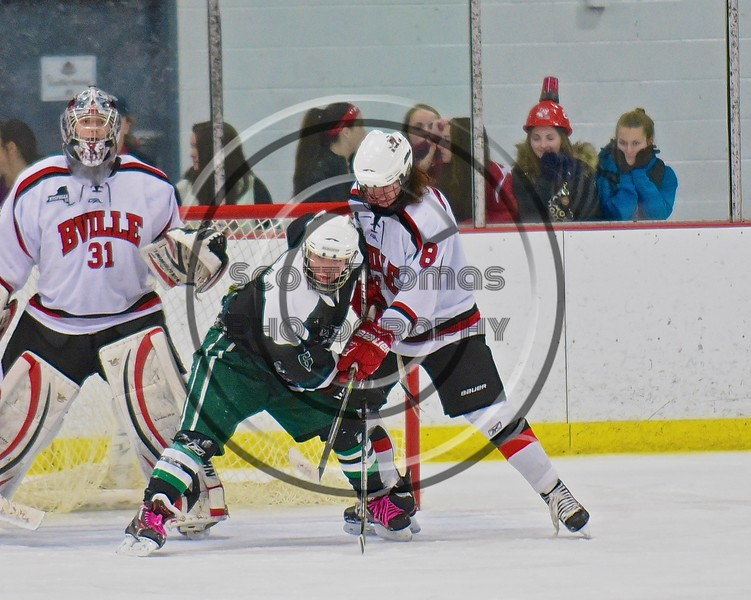 Baldwinsville Bees Riley Smith (8) battles with a Fayetteville-Manlius Hornets player in front of Bees goalie Matt Sabourin (31) at the Lysander Ice Arena in a Section III Division I Boys Hockey Playoff game at Baldwinsville, New York on Thursday February 18, 2016.  Baldwinsville won 5-0.