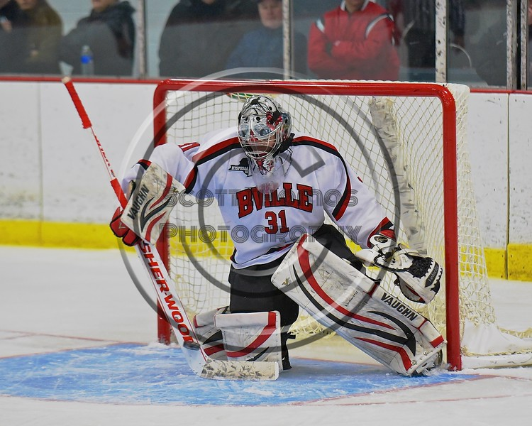 Baldwinsville Bees goalie Matt Sabourin (31) makes a stick save against the Fayetteville-Manlius Hornets at the Lysander Ice Arena in a Section III Division I Boys Hockey Playoff game at Baldwinsville, New York on Thursday February 18, 2016.  Baldwinsville won 5-0.