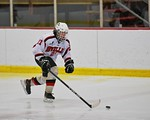 Baldwinsville Bees Noah Lindsay (21) with the puck against the Fayetteville-Manlius Hornets at the Lysander Ice Arena in a Section III Division I Boys Hockey Playoff game at Baldwinsville, N ...