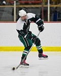 Fayetteville-Manlius Hornets Tommy Guilfoil (24) looking to make a play against the Baldwinsville Bees at the Lysander Ice Arena in a Section III Division I Boys Hockey Playoff game at Baldw ...