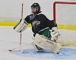 Fayetteville-Manlius Hornets goalie James Kaffenberger (30) makes a save against the Baldwinsville Bees at the Lysander Ice Arena in a Section III Division I Boys Hockey Playoff game at Bald ...