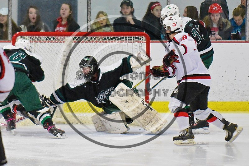 Fayetteville-Manlius Hornets goalie James Kaffenberger (30) stretches out to keep the puck out of his nest against the Baldwinsville Bees at the Lysander Ice Arena in a Section III Division I Boys Hockey Playoff game at Baldwinsville, New York on Thursday February 18, 2016.  Baldwinsville won 5-0.