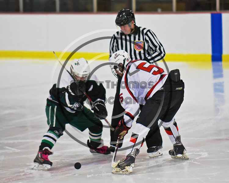 Baldwinsville Bees Isaiah Pompo (5) facing off with a Fayetteville-Manlius Hornets player to start the second period at the Lysander Ice Arena in a Section III Division I Boys Hockey Playoff game at Baldwinsville, New York on Thursday February 18, 2016.  Baldwinsville won 5-0.