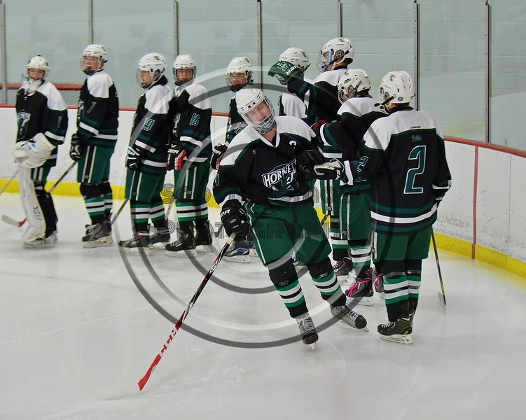 Fayetteville-Manlius Hornets Trevor Pokine (21) being introduced before playing the Baldwinsville Bees at the Lysander Ice Arena in a Section III Division I Boys Hockey Playoff game at Baldwinsville, New York on Thursday February 18, 2016.
