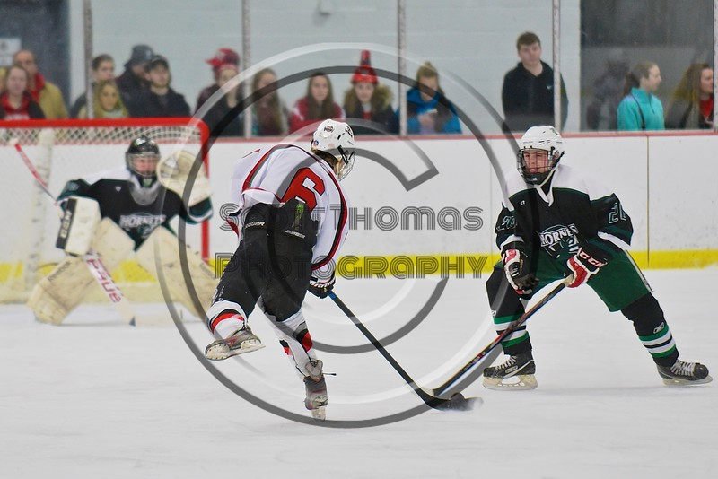 Baldwinsville Bees Josh Racha (6) gets ready to shoot the puck at the Fayetteville-Manlius Hornets net at the Lysander Ice Arena in a Section III Division I Boys Hockey Playoff game at Baldwinsville, New York on Thursday February 18, 2016.  Baldwinsville won 5-0.