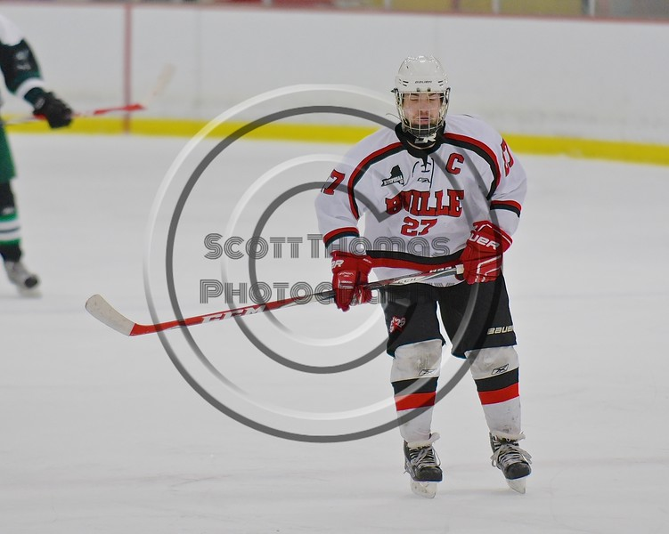 Baldwinsville Bees Matt Metcalf (27) on the ice against the Fayetteville-Manlius Hornets at the Lysander Ice Arena in a Section III Division I Boys Hockey Playoff game at Baldwinsville, New York on Thursday February 18, 2016.  Baldwinsville won 5-0.