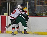 Baldwinsville Bees Brett Sabourin (39) separates the puck from Fayetteville-Manlius Hornets Zack Wisby (6) at the Lysander Ice Arena in a Section III Division I Boys Hockey Playoff game at B ...