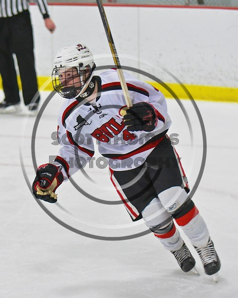 Baldwinsville Bees JP Clappa (4) raises his stick to celebrate his goal against the Fayetteville-Manlius Hornets at the Lysander Ice Arena in a Section III Division I Boys Hockey Playoff game at Baldwinsville, New York on Thursday February 18, 2016.  Baldwinsville won 5-0.