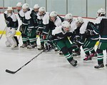 Fayetteville-Manlius Hornets Ben Hammond (22) being introduced before playing the Baldwinsville Bees at the Lysander Ice Arena in a Section III Division I Boys Hockey Playoff game at Baldwin ...