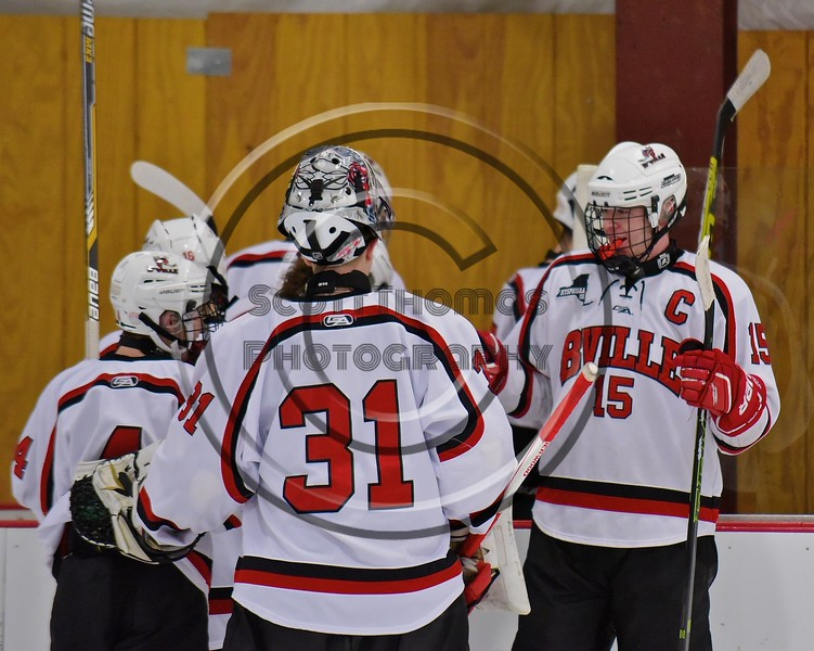Baldwinsville Bees Senior Captain Charlie Bertrand (15) greets teammates after defeating the Fayetteville-Manlius Hornets at the Lysander Ice Arena in a Section III Division I Boys Hockey Playoff game at Baldwinsville, New York on Thursday February 18, 2016.  Baldwinsville won 5-0.